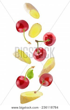 Isolated Flying Fruits. Isolated Falling Cherries And Ginger On White Background With Clipping Path