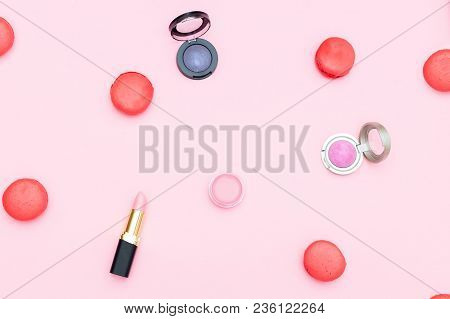 Cosmetics And Sweets Macaroons On A Pink Background. Creative Pastel