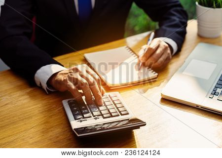 Businessman Accouting Management With Calculator Marketing Report Taking Note Balance Of Money State