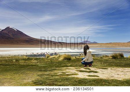Young Woman At Laguna Colorada At Eduardo Avaroa Andean Fauna National Reserve In Bolivia