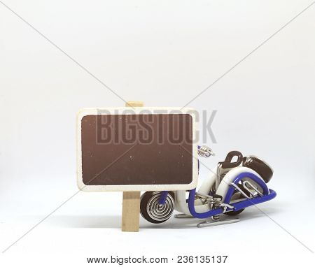 Concept Image,blank Chalkboard And Handcrafted Motorcycle On White Background. Light Effect On Left.