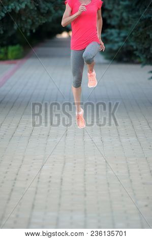 Girl Stretching Her Legs And Preparing For A Marathon