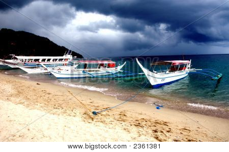 Boats On Puerto Galera  In The Philippines