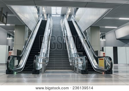 Entrance Of Moving Escalator In Modern Building To A Subway Station