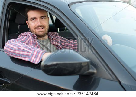 Cheerful Man In His New Car And Smiling At Camera
