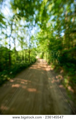 Out Of Focus Image Of Road In Forest