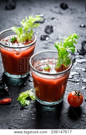 Bloody Mary Cocktail With Fresh Tomatoes On Black Rock