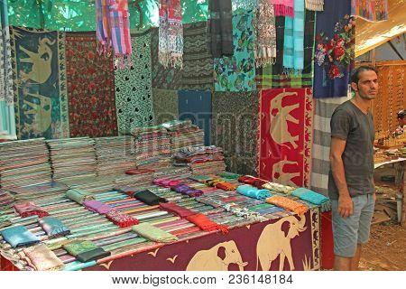 India, Goa, January 24, 2018. Indian Man Salesman In The Anjuna Market, Goa, India. Indian Markets,