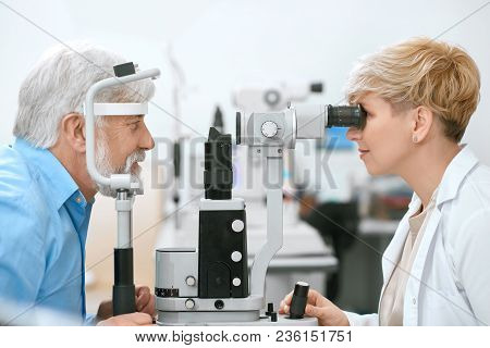 Oculist Cheking Patient's Vision With Medical Equipment.