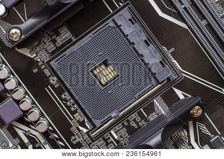 Fragment Microcircuit Of The Motherboard Or Mainboard With Slot And Battery As Background . Printed