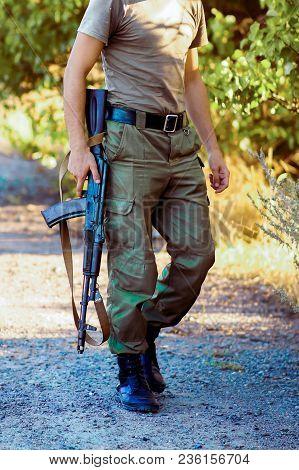 Man Holding Black Rifle On Desert Range Close Up