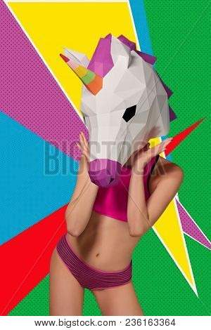 Slim Model Wearing Colorful Unicorn's Head, Posing On Saturated Background.