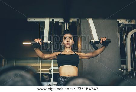 Strong Asian Sporty Women Exercise Gym Club.