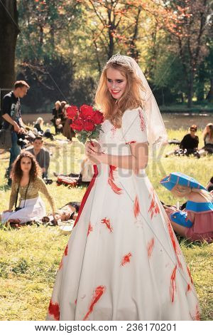 April, 19, 2014, Haarzuilens, The Netherlands: Beautifully Dressed Lady Poses In The Park During The