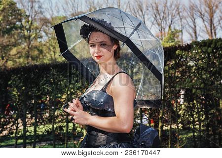 April,19, 2014, Haarzuilens, The Netherlands: Beautiful Black  Dressed Lady With Umbrella Poses In T