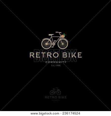 Retro Bike Logo. Vintage Bike With Basket. Retro Bike Community Emblem. Gold Bike On A Dark Backgrou