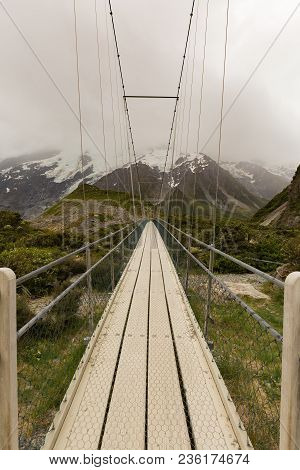 Suspension Bridge And Wooden Path In To National Park New Zealand Natural Landscape Background