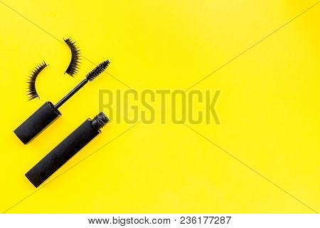 Basic Products For Eyelashes Makeup. Mascara And False Eyelashes On Yellow Background Top View.