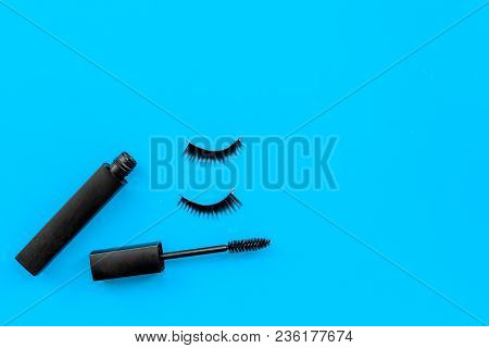 Basic Products For Eyelashes Makeup. Mascara And False Eyelashes On Blue Background Top View.