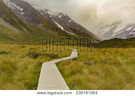 Wooden Walking Path Leading To Hooker Valley Track, New Zealand Natural Landscape Background
