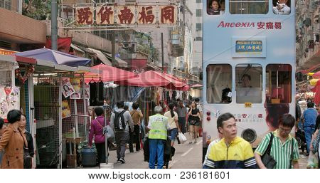 North Point, Hong Kong, 16 March 2018:- Hong Kong wet market with tramway crossing the road