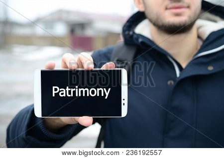 A Young Guy Shows An Inscription On The Smartphone's Display On