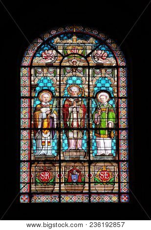 PARIS, FRANCE - JANUARY 09: Saint Denis, stained glass window in the Saint Roch Church, Paris, France on January 09, 2018.