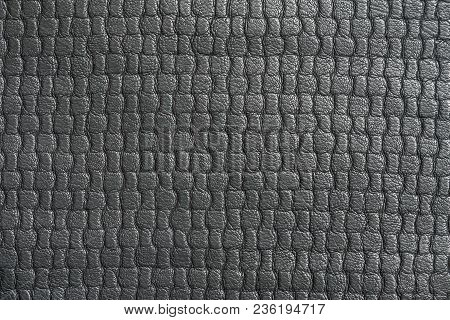 Macro Texture Of Black Leather With Embossed Pattern
