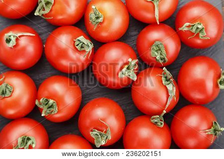 Fresh Tomatoes. It Can Be Used As Background. (selective Focus).delicious Red Tomatoes. A Pile Of To