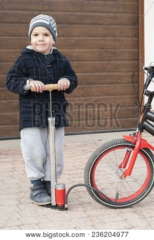 Little Boy And A Bicycle Pump
