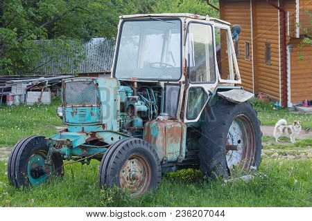 Old Rusty Soviet-made Tractor In The Farmyard. Transport