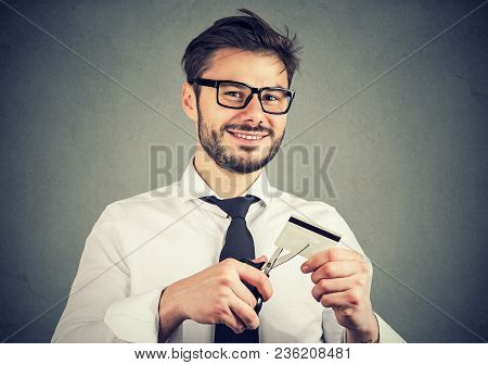 Cheerful Young Business Man Looking Happily At Camera Done With Credit Cards.