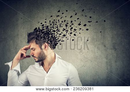 Memory Loss Due To Dementia Or Brain Damage. Side Profile Of A Man Losing Parts Of Head As Symbol Of