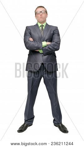 Angry Arrogant Businessman Is Standing With Crossed Arms Isolated On White Background. Dissatisfied