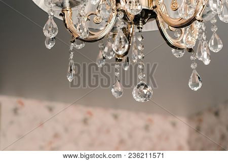 Beautiful Golden Chandelier With Glass Details On Light Background Interior Concept