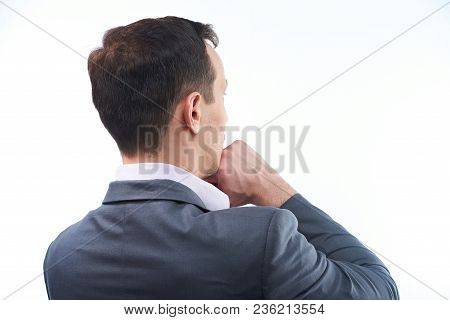 Back View Of Thinking Man. Man With Hand Under Chin