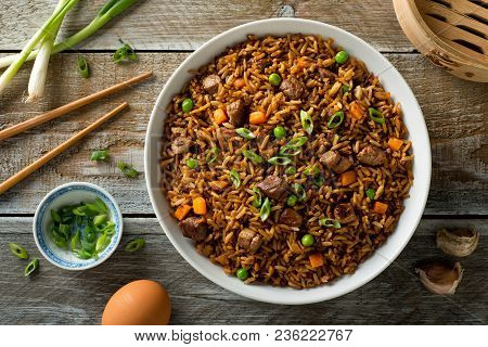 Delicious Beef Fried Rice With Egg, Carrot, Garlic, Green Peas And Scallions.