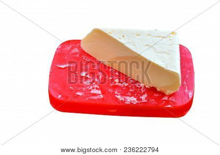 A Triangular Piece Of Butter, Butter On A Red Stand, A Large Piece Of Butter
