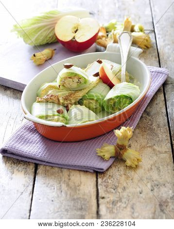 Chinese Cabbage Rolls With Apple And Hazelnut Filling.
