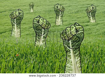 Raised Green Fists in Grass Field