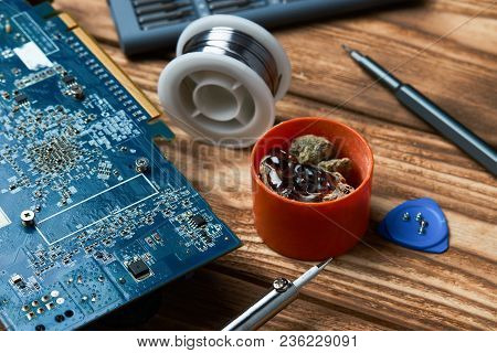 Repair Of Electronic Devices, Tin Soldering Parts, Close Up. Electronic Manufacturing And Repair Con