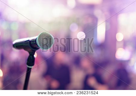 Close Up Microphone On Stage In Concert Hall Restaurant Or Conference Room. Blurred Background.