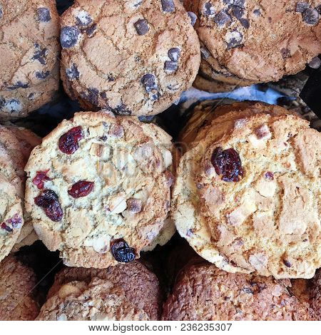 Delicious Selection Of Cookies, Including Chocolate Chip Cookies And Cranberry And Raisin Cookies. S