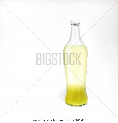 Transparent Glass Bottle With Lemonade Is Standing On White Background Photo Mockup In Front View Wi