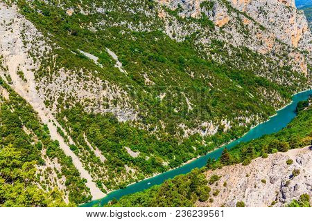 Magnificent French Alps. The river Verdon flows along the bottom of the canyon. A fascinating journey through the mountain Provence. Concept of active, ecological and extreme tourism