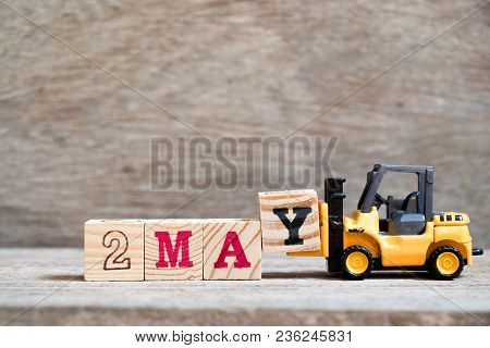 Toy Forklift Hold Block Y To Complete Word 2 May On Wood Background (concept For Calendar Date For M