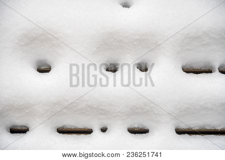 Detail Of Deck Of Home In Winter With Snow
