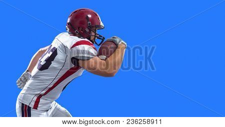 American football Player running with the ball isolated on a colorful background