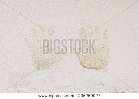 Close Up Or Dirty Handprints Stained On White Wall In Nature Light