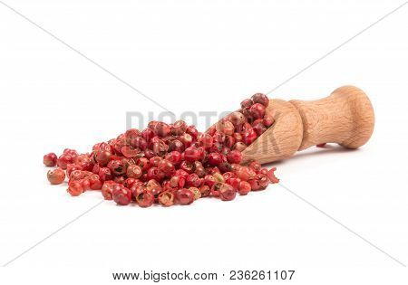 Pink Pepper, Red Peppercorns In A Wooden Spoon.